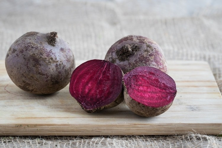 beets sitting on cutting board