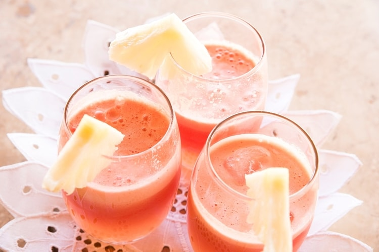 smoothies in glass with pineapple slices