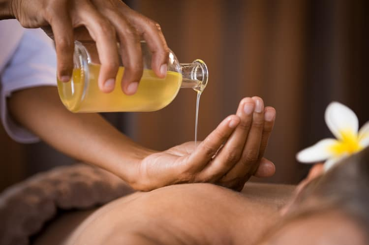 how to use essential oils for nausea massage