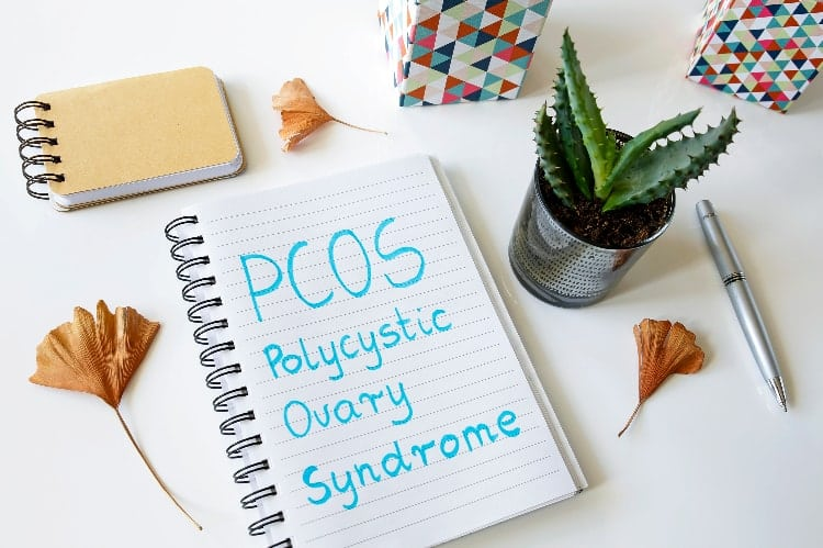 notebook with polycystic ovary syndrome written down