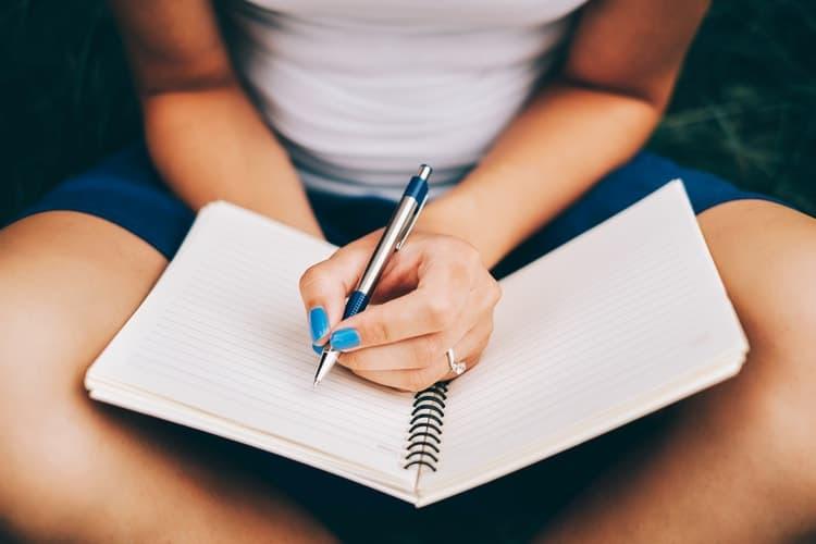 unusual self care ideas woman writing